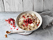 Porridge with apples, raisins and pomegranate seeds