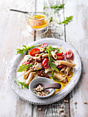 Italian pasta salad with rocket and pinenuts