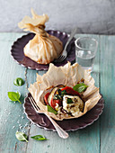 Aubergine and feta cheese parcels in parchment paper