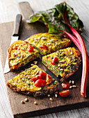 Chard and tomato omelette with pine nuts