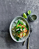 Spicy prawn and pineapple poke bowl with white rice, and coconut