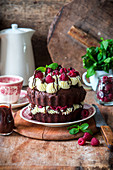 Chocolate cake with cream cheese and raspberries