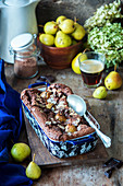 Chocolate cake with pears and almonds in a tray