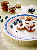 Chocolate whoopie pies with blueberry cream cheese