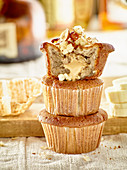 Banana and spelt muffins topped with nuts and honey
