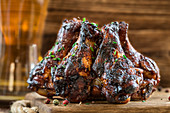 BBQ chicken wings on a wooden board