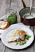 Vegetable strudel with warm chive sauce