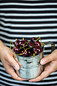 Cherries in a measuring cup
