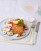 Baked cod with a cucumber and radish salad