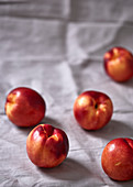 Nectarines on a white tablecloth