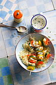 Fish and vegetable skewers with rice