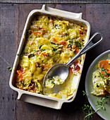 Potato bake with pastrami, parsnips and carrots