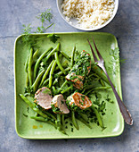 Pork fillet with a herb coating and green beans