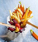 Colourful vegetable oven fries with ketchup