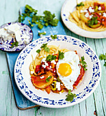 Turkish vegetable pasta with feta cheese and fried eggs