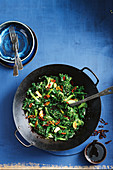 Wok-tossed greens with crispy garlic and chilli