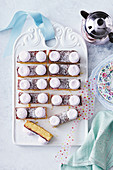 Biscuit bars with raspberry jam, grated coconut and marshmallows