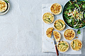 Asparagus and brie tarts with a spinach salad