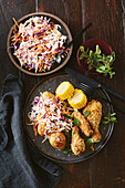 Crispy cajun chicken with corn and slaw potatoes