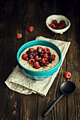 Oatmeal porridge with almond milk and berries