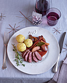 Venison medallions with potato and saffron dumplings and port wine infused shallots