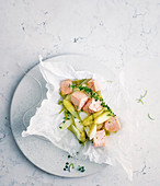 Salmon and white asparagus in parchment paper