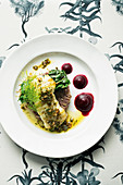 Fillet of white fish with browned butter, capers, tapenade, potatoes and Swiss chard