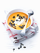 Creamy pumpkin soup with pumpkin seeds and pumpkin seed oil