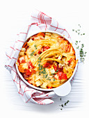 Pasta casserole with tomatoes, cheese and thyme
