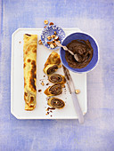 Pancake rolls filled with chocolate and nut spread