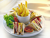 Club sandwiches with french fries
