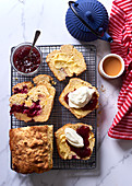 Cranberry scone bread with butter, raspberry jam and whipped cream