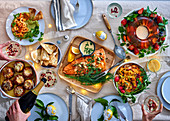 A Chrismas spread with salmon, prawns with avocado mousse, corn and chedder souffles, carrot salad, and strawberry and prosecco jelly