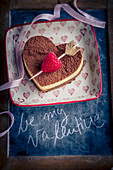 Heart shaped tiramisu with Cupid's arrow and lettering for Valentine's Day