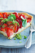 A slice of strawberry tart with herb sugar