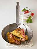 French toast with bacon in a pan