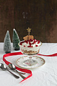 Christmas pear dessert with gingerbread cream and pomegranate seeds