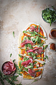 Home made pizza with prosciutto and ruccola