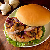 Grilled chicken sandwich with grilled mushrooms and onions