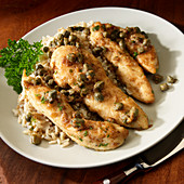 Chicken Picant on brown rice with white wine and capers