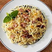 Angel hair pasta with prosciutto, pine nuts, sun dried tomato, basil