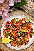 Marinated, grilled sea bass fillets with spicy salsa