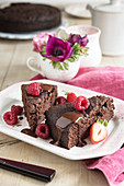 Chocolate beetroot cake with chocolate sauce and berries