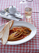 Braised chicory served with bread