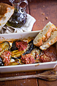 An aubergine bake with white bread
