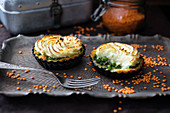 Red lentil quiches with a spinach and pea filling and potato topping (vegan)