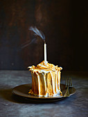 Lemon meringue cake with blowed candle