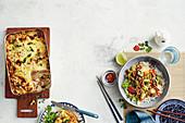 Blumenkohl-Käse-Lasagne und Schweinehackfleisch-Pfanne süß-sauer