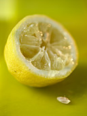 A partially squeezed lemon half (close-up)