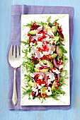 Rocket salad with beetroot, avocado, feta cheese and pomegranate seeds